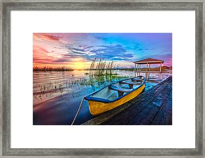 Yellow Canoe Framed Print by Debra and Dave Vanderlaan