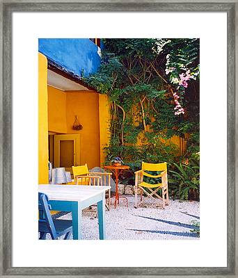Yellow Chairs Framed Print by Andrea Simon