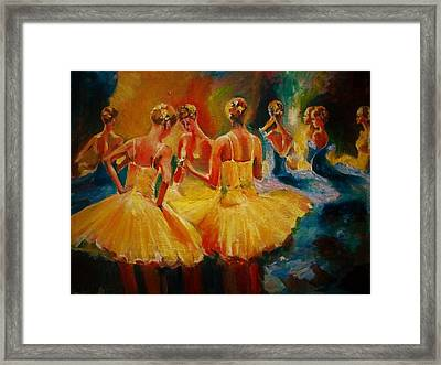 Yellow Costumes Framed Print by Khalid Saeed