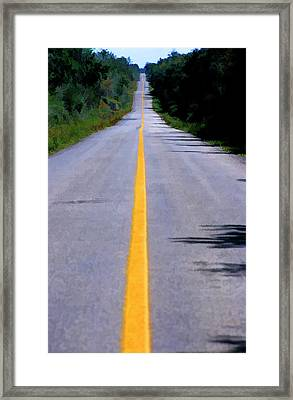 Yellow Dividing Line Marking An Empty Road Between Uxmal And Kabah Framed Print by Sami Sarkis