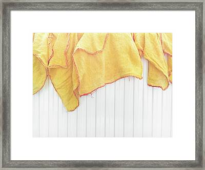 Yellow Dusting Cloths Framed Print