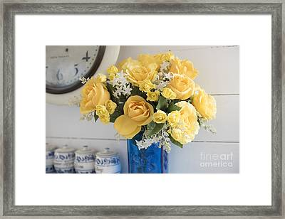 Yellow Flowers In A Blue Vase Framed Print