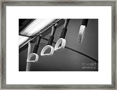 Yellow Hand Holds For Standing Customers On A Bus In The Uk Framed Print by Joe Fox