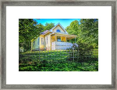 Yellow House On The Hill Framed Print