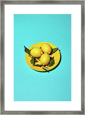 Yellow Lemons On Cyan Framed Print by Oleg Cherneikin
