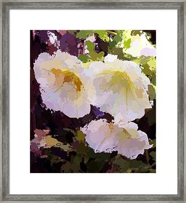 Framed Print featuring the photograph Yellow Petunias by Carol Grimes