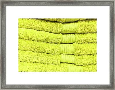 Yellow Towels Framed Print by Tom Gowanlock