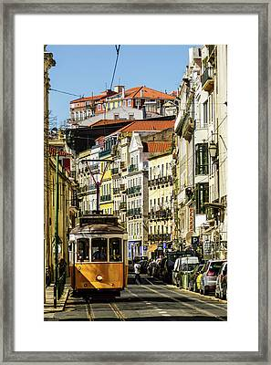 Yellow Tram In Downtown Lisbon, Portugal Framed Print