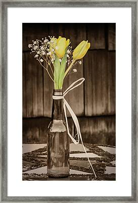 Framed Print featuring the photograph Yellow Tulips In Glass Bottle Sepia by Terry DeLuco