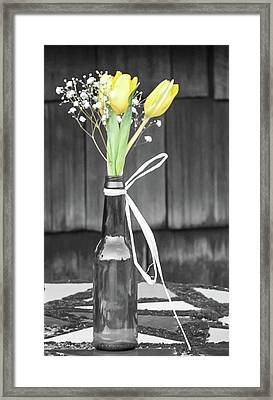 Framed Print featuring the photograph Yellow Tulips In Glass Bottle by Terry DeLuco