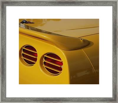 Yellow Vette Lights Framed Print by Rob Hans