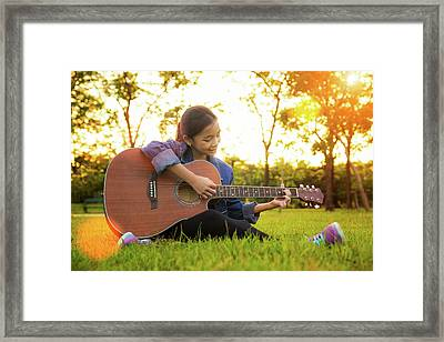 Young Artist Play Solo Guitar In Green Nature Park Framed Print