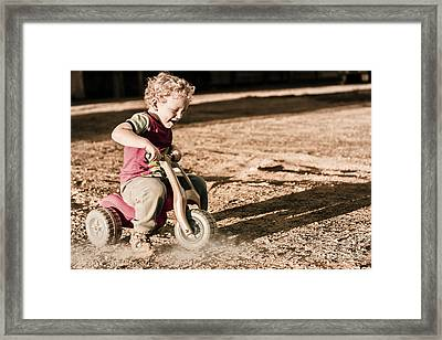 Young Boy Breaking At Fast Pace On Toy Bike Framed Print by Jorgo Photography - Wall Art Gallery