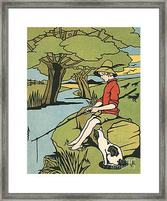 Young Boy Sitting On A Log Fishing In A Small River In The Country With His Cat Framed Print by American School