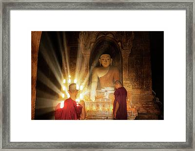 Young Buddhist Monk Are Reading With Sun Light Framed Print by Anek Suwannaphoom