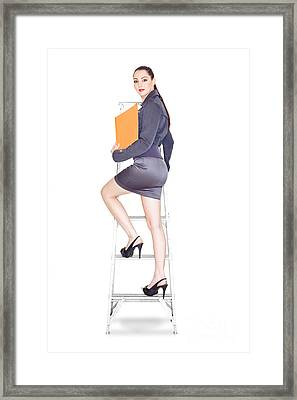 Young Business Woman Climbing The Corporate Ladder Framed Print by Jorgo Photography - Wall Art Gallery