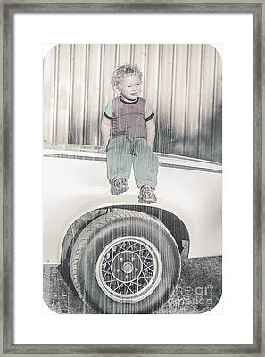 Young Child Sitting On The Bonnet Of A Muscle Car Framed Print