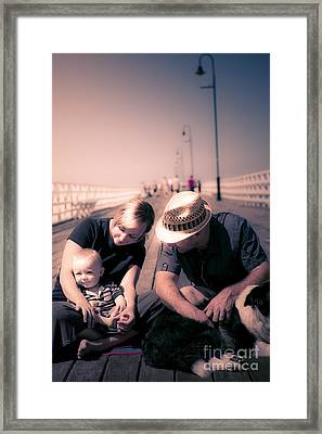 Young Couple And Baby Boy Sitting On The Boardwalk Framed Print by Jorgo Photography - Wall Art Gallery