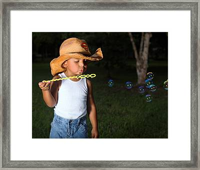 Young Cowboy Blowing Bubbles Framed Print