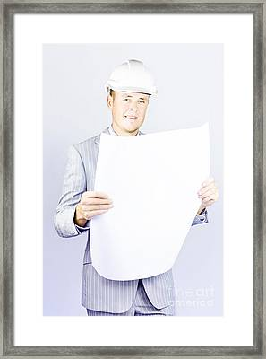 Young Engineer Looking At His Blueprint Framed Print by Jorgo Photography - Wall Art Gallery