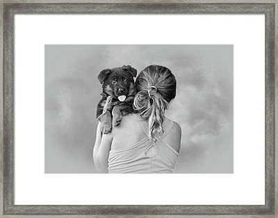 Young Girl And Puppy Framed Print