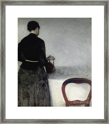 Young Girl Pouring Tea  Framed Print