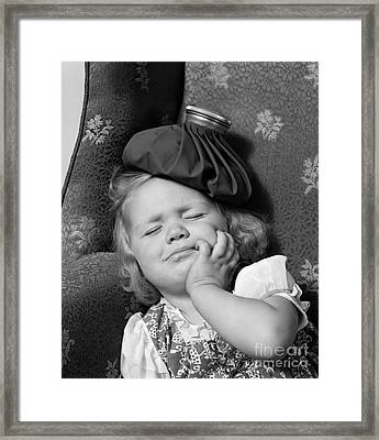 Young Girl With Ice Pack On Head Framed Print by H. Armstrong Roberts/ClassicStock