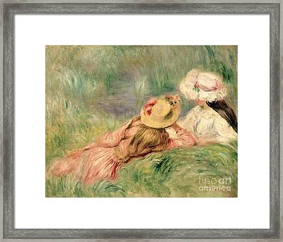 Young Girls On The River Bank Framed Print by Pierre Auguste Renoir