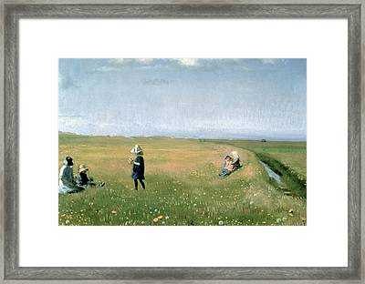 Young Girls Picking Flowers In A Meadow Framed Print