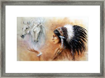 Young Indian Woman Wearing A Gorgeous Feather Headdress With An Image Of Two White Horse Framed Print by Jozef Klopacka