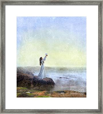 Young Lady Releasing A Dove By The Sea Framed Print