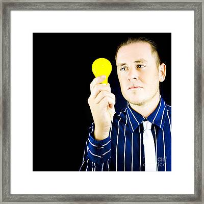 Young Man Holding Light Bulb In Hand Framed Print by Jorgo Photography - Wall Art Gallery