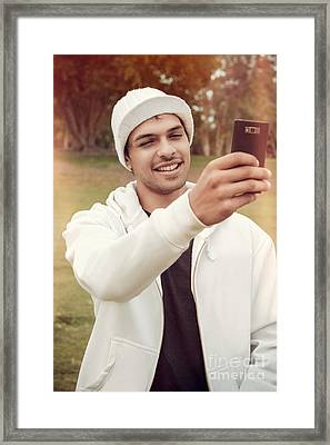 Young Man In Mid-twenties Taking Mobile Photo Framed Print