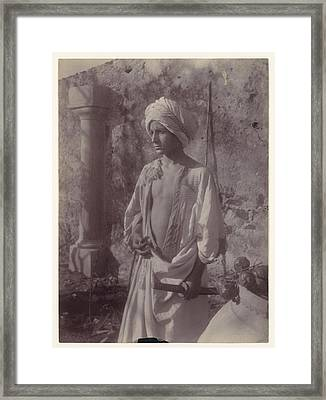 Young Man In White Robe And Head Gear Holding Scabbard Framed Print