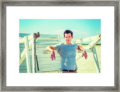 Young Man Relaxing On The Beach Framed Print