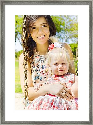 Young Mom With Her Baby Girl On A Swing Outside Framed Print by Jorgo Photography - Wall Art Gallery