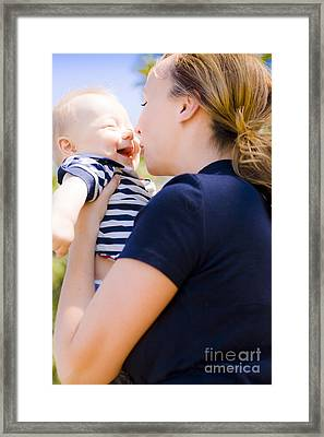 Young Mother Enjoying A Moment With Her Baby Framed Print