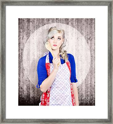 Young Pinup Housewife Thinking What To Cook Framed Print by Jorgo Photography - Wall Art Gallery