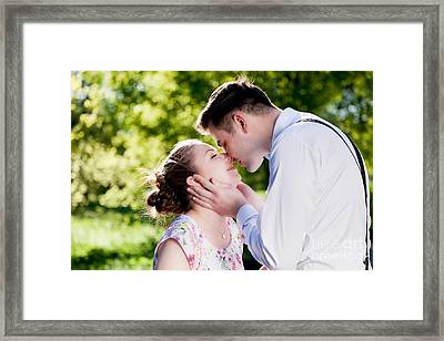 Young Romantic Couple Kissing With Love In Summer Park Framed Print