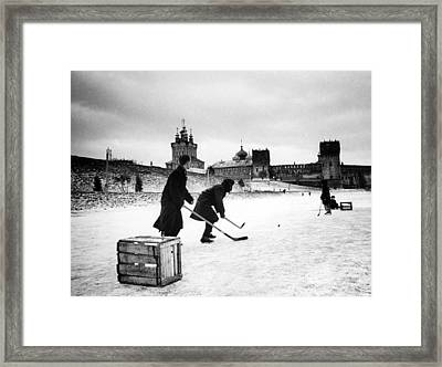 Young Russians Playing Hockey Framed Print by Everett