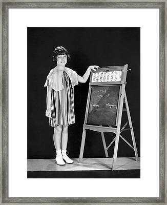 Young Student At Blackboard Framed Print by Underwood Archives