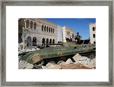 Young Syrian Boys On Top Framed Print by Andrew Chittock