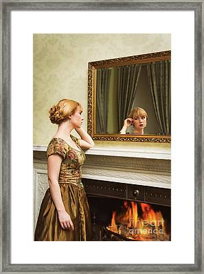 Young Woman At Fireplace Framed Print by Amanda Elwell