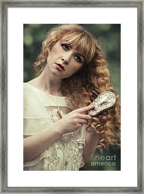 Young Woman Brushing Her Hair Framed Print by Amanda Elwell