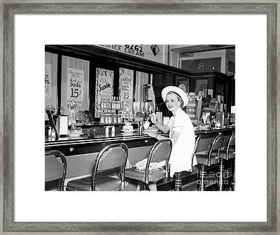 Young Woman Eating Ice Cream, C. 1930s Framed Print by H. Armstrong Roberts/ClassicStock