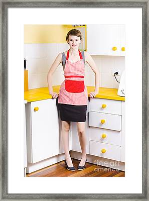 Young Woman In Kitchen Framed Print