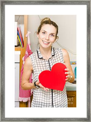 Young Woman In Mid 20s Holding Red Love Heart Framed Print by Jorgo Photography - Wall Art Gallery