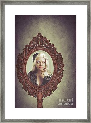 Young Woman In Mirror Framed Print
