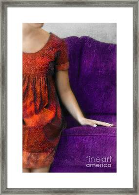 Young Woman In Red On Purple Couch Framed Print by Jill Battaglia