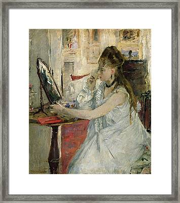 Young Woman Powdering Her Face Framed Print by Berthe Morisot